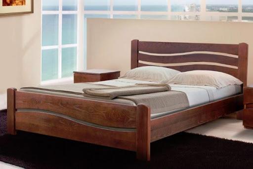 Деревянные кровати: причины популярности